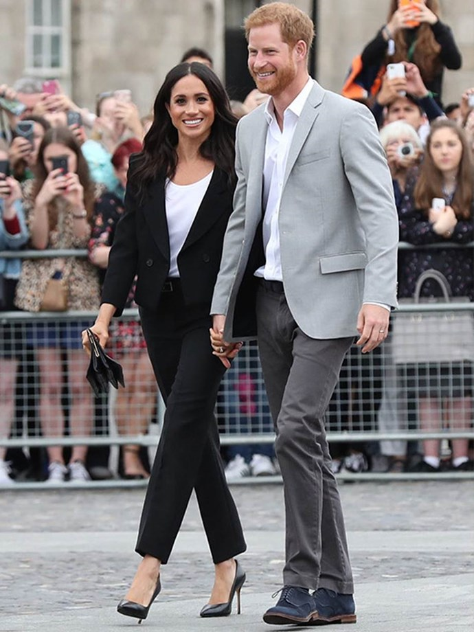 Meghan stunned in this Givenchy paintsuit, reminding us all of the pre-wedding Meghan we came to know and love. The Duchess paired this iconic outfit with a $59 shirt by Lavender Hill, a Givenchy belt, Givenchy bag, and Sarah Flint heels.