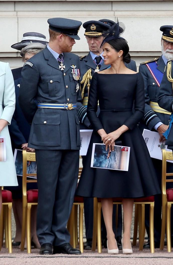 The Duchess of Sussex stunned in this black custom Dior dress at the RAF 100th anniversary celebrations. Meghan accessorised her favoured bateau neckline dress with a small black clutch and nude pumps, also by Dior, and a black fascinator by Stephen Jones. Simply divine!