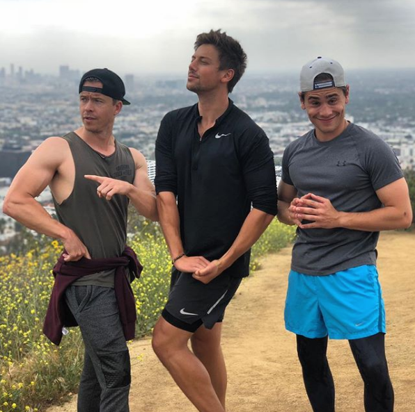 "Todd Lasance, Lincoln Younes and Christian Antidormi strike a pose while hiking Runyon's Canyon in LA. ""No flex zone,"" Lincoln captioned his Instagram post."