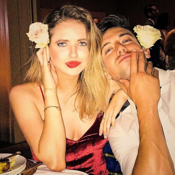 Kassandra Clementi and Lincoln Younes rock matching flowers in their hair at a friends wedding over the weekend.