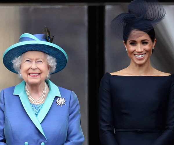 Queen Elizabeth and Meghan watched the RAF flypast on the balcony of Buckingham Palace, to mark the centenary of the RAF on July 10, 2018 in London.