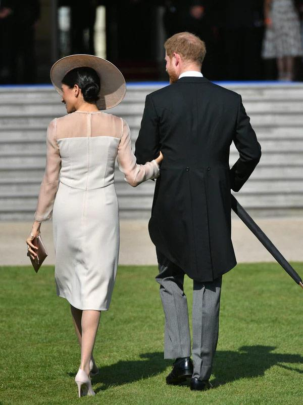 """Their first outing, a garden party, just days after they said """"I do!"""""""