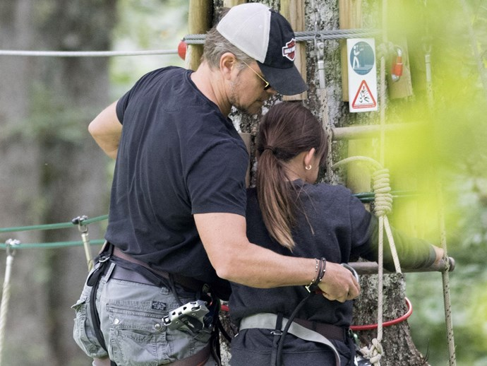 Matt Damon helps his daughter fasten her harness for some tree top walking.