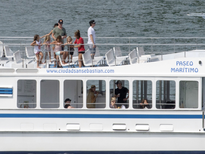 The two families (that's Chris and family on the top deck), took a boat trip before spending time diving and swimming.