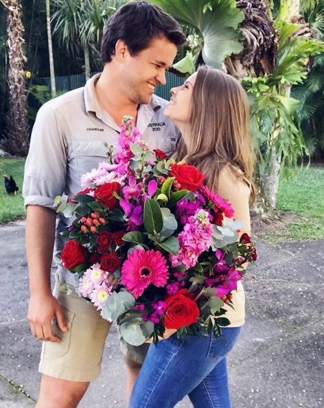 Chandler surprised her with a big bunch of flowers for her 20th birthday and the two look as loved-up as ever!
