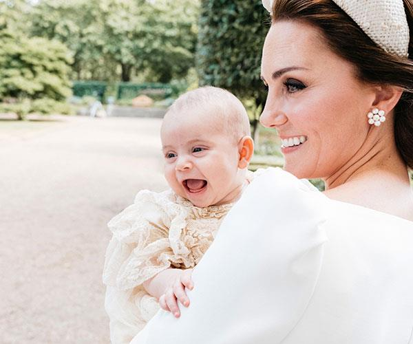 While he may have slept through the ceremony, little Louis was bright-eyed and beaming behind-the-scenes with mum. *(Image/Matt Poreous)*