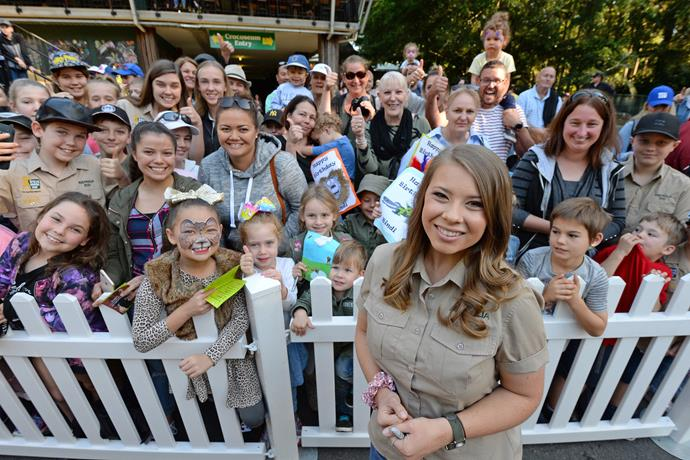 Bindi smiles as she's surrounded by adoring fans at the zoo