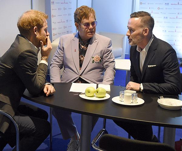 Elton and his partner David chat to Harry.
