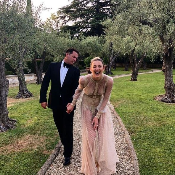 The couple were super loved-up at a friend's recent wedding in Italy.