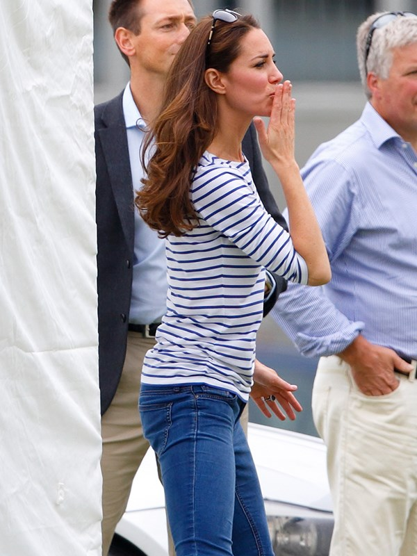 The Duchess blows a kiss at the polo in England.