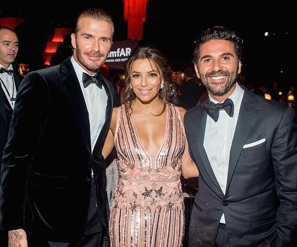 The new parents pictured with their dear friend David Beckham.