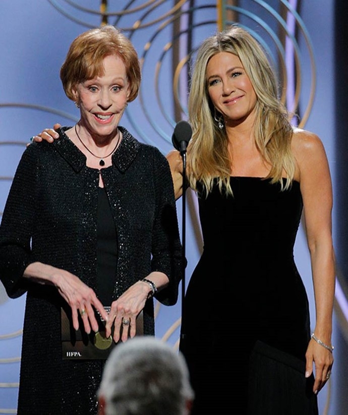 Jen wore black to support the Time's Up movement at the 2018 Golden Globes ceremony. Pictured with Carol Burnett.