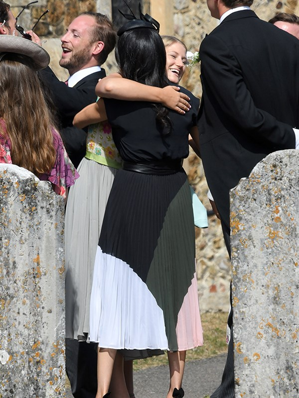 Meghan greets friends at the entrance to the church.