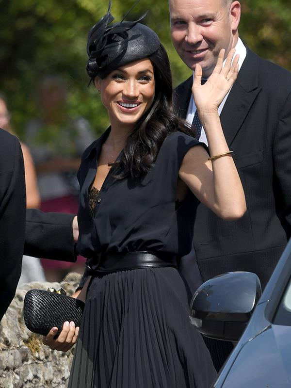 Oops! Meghan's button came unclasped revealing a hint of lace.