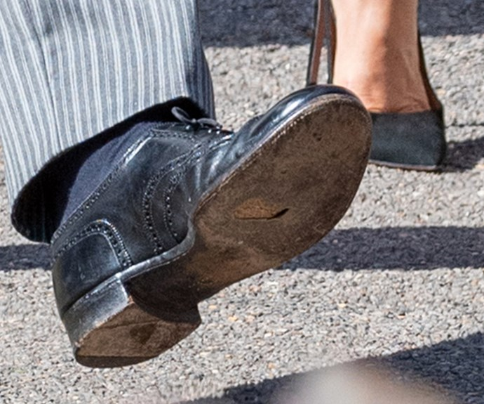 Until...A close up of Harry's black brogues reveals the Prince has a hole in his sole!