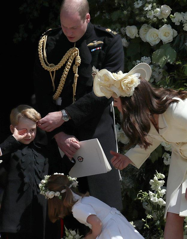 The entire Cambridge clan rally around young George when he had a moment at Harry's wedding.