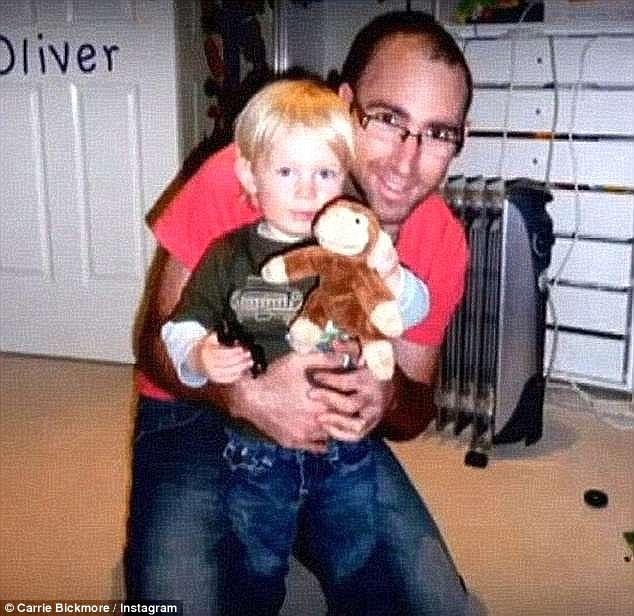 Carrie's late husband Greg with their son Ollie, now 10.