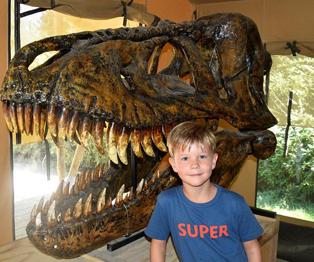 Like father, like son! Prince Vincent also takes a keen interest in the prehistoric creatures.