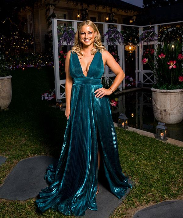 "**Romy, 29, QLD** Romy, who works as a photoshoot director, sees herself as a bit of a bogan. She describes herself as spontaneous, fun, confident, adventurous and loyal.  **READ MORE: ['Romy came in hot' for first kiss with Nick Cummins!](https://www.nowtolove.com.au/reality-tv/the-bachelor-australia/the-bachelor-australia-shannon-baff-50671|target=""_blank"")**"