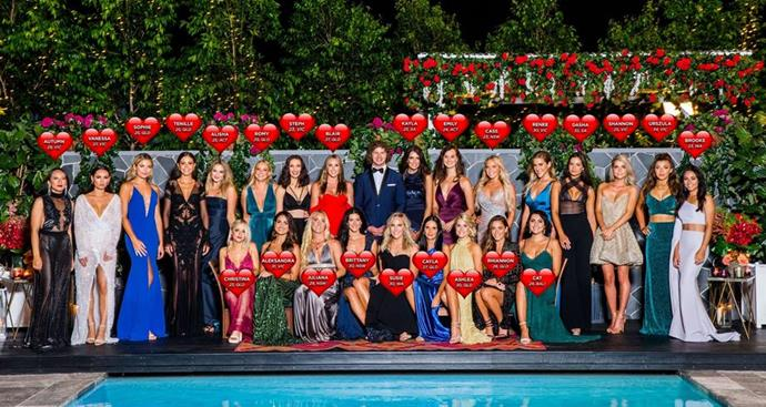 A footy player between Bachelorettes!