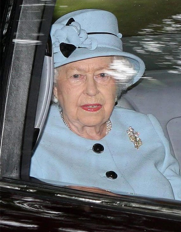 Queen Elizabeth looked resplendent in a pastel blue overcoat and matching hat.