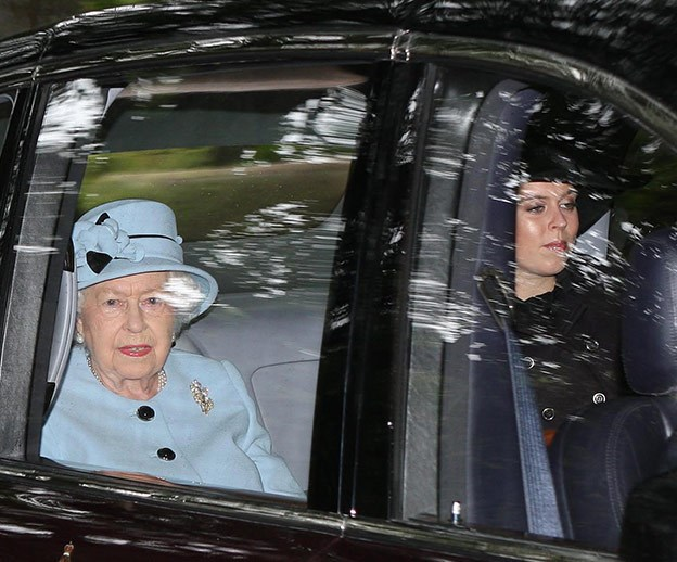 Her Majesty and Princess Beatrice make their way to the Sunday church service.