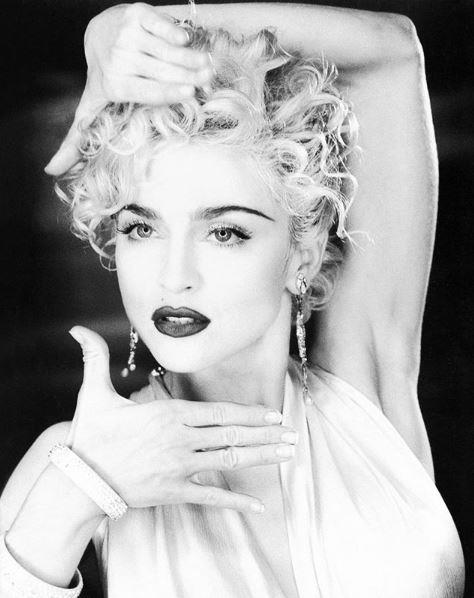 Strike a pose, there's nothing to it. Madonna taught the world to *Vogue* in 1990.