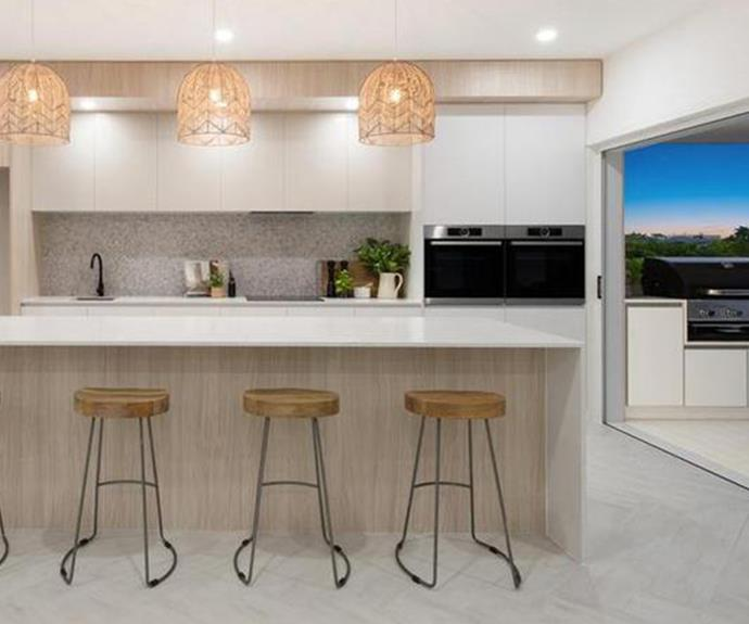 A brand new kitchen leads to an open outdoor entertaining area, perfect for family meals in the summer time. *Image: realestate.com.au*
