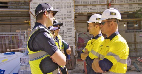 Foremen Dan and Keith intercept the police.