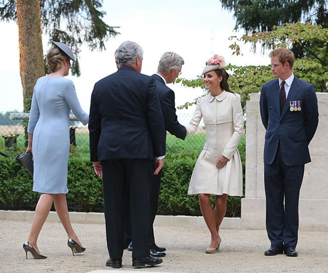 Duchess Catherine's been giving lessons in the elegant bob since she officially joined the royal family in 2011. Here, she greets King Philippe of Belgium with Prince Harry in 2014.
