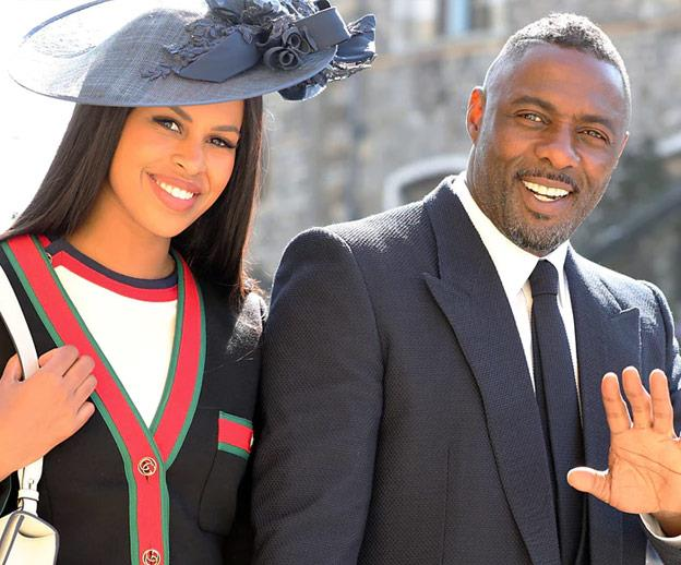Idris with his fiancée Sabrina Dhowre at Harry's wedding.