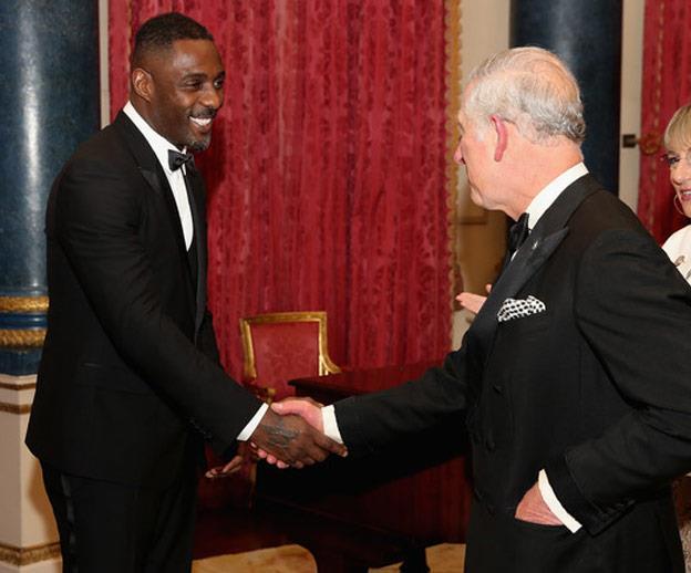 Idris with Prince Charles.