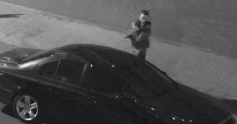 CCTV image shared by the Queensland Police Service shows the boy being carried into a car.