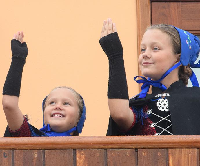 Princesses Isabella and Josephine have the royal wave down pat.