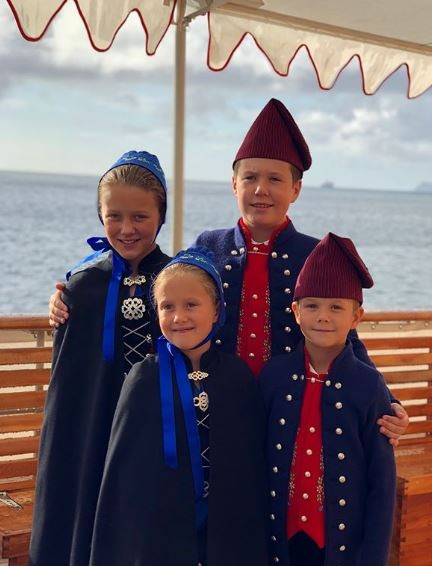 The four children are accompanying their parents on official royal duties.