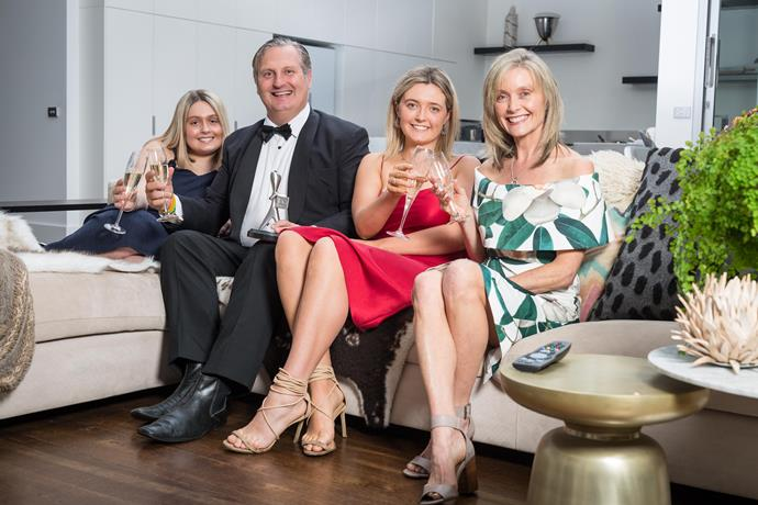 Husband and wife Matt and Katherine, cheers with their daughters Holly (far left) and Millie.