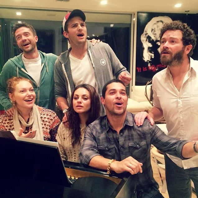The cast catch up for a musical sing-a-long.