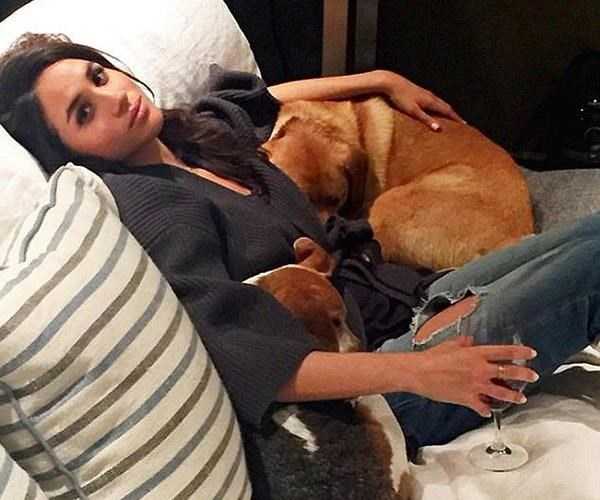 Meghan with rescue dogs, Bogart and Guy.
