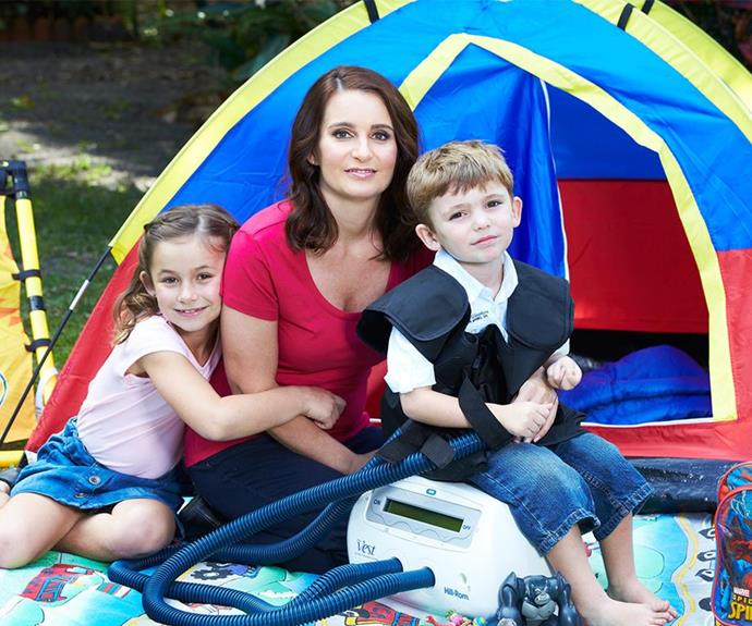 Reggie, pictured in 2016 with daughter Mia and son Lucas strapped into his breathing machine, is campaigning tirelessly to raise awareness for cystic fibrosis.