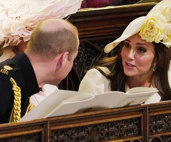 Kate and Wills share a fun moment at Harry's wedding.