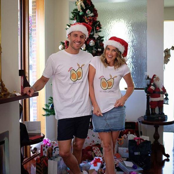 "And these two sure do love a pun. Their festive T-shirts say, ""Avo Merry Christmas."""