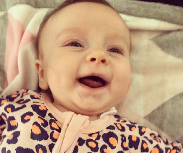 Look at that little face. Look closely and you'll see Erin has smooshed her little cheeks with lipstick kisses. How could you not? *Image: Instagram/Erin Molan*