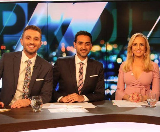 "The star's co-hosts Tommy Little and Waleed Aly match their ties to Carrie's pink wraparound dress. It's available from [Boohoo](https://www.boohoo.com/maternity-ruffle-sleeve-wrap-dress/BZZ48316.html|target=""_blank""