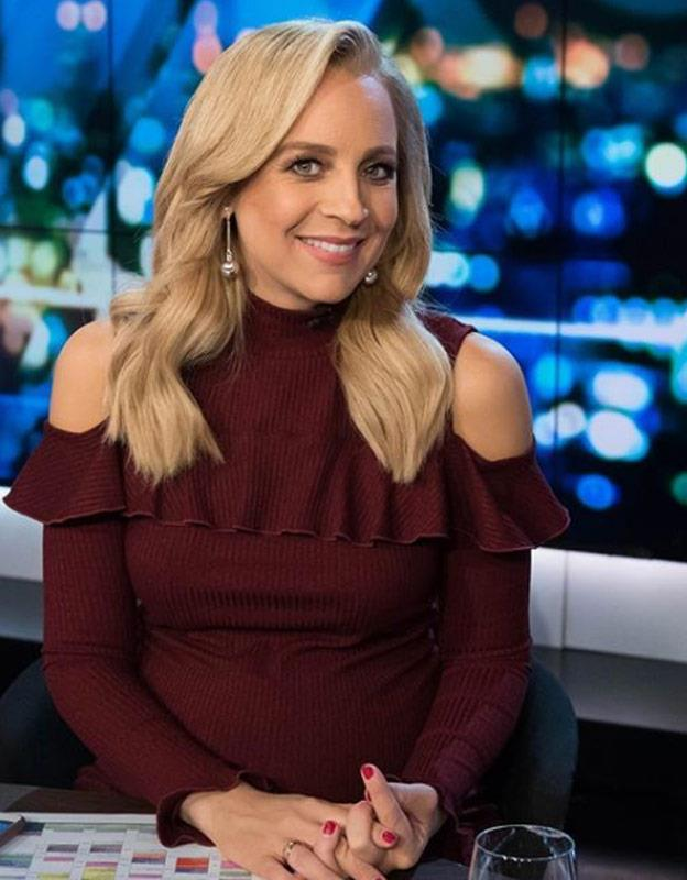 Carrie revealed she suffered terrible morning sickness during her third pregnancy, but you wouldn't know it as she glows in a burgundy Nicholas The Label cold-shoulder dress.