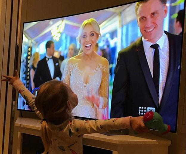 Little Evie, Carrie's second child but first child with her partner Chris, spotted her mummy on the telly! Too cute.