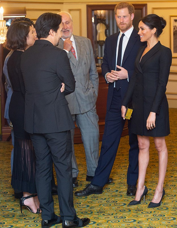 Opting to show off her pins, Meghan wowed in a LBD.