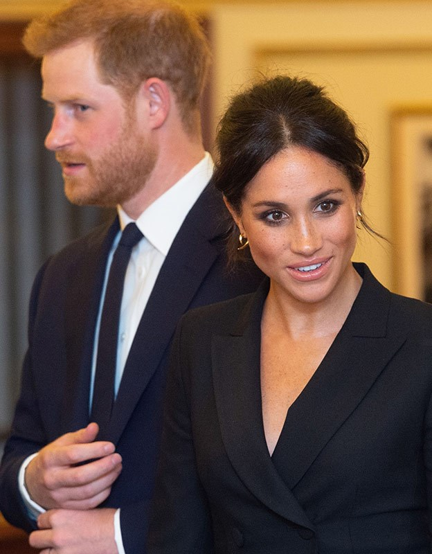 Meghan's beautiful freckles are highlighted in a stunning way thanks to minimal make up and a smokey eye.