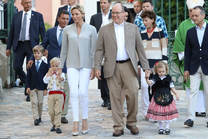 The blonde tots accompanied their parents Prince Albert and Princess Charlene to the town's end of summer picnic, dressed in traditional costume