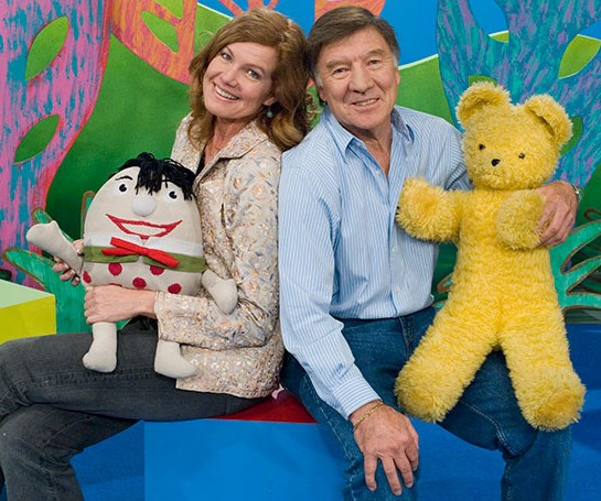"""Don Spencer (pictured here with Angela Moore) was a *Play School* presenter from 1968 - 1999. In 2007 he was honoured with a Medal of the Order of Australia for  """"for service to children's music and television as a songwriter and performer, and through the establishment of the Australian Children's Music Foundation"""". His daughter Danielle Spencer was married to Russell Crowe."""