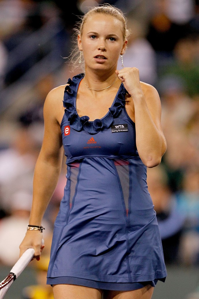 **Caroline Wozniacki, Indian Wells 2011** <br><br> Wozniacki's partnership with Adidas by Stella McCartney has led her to don some trendy garments over the years. The ruffled neckline on this navy-blue dress looked perfectly chic.